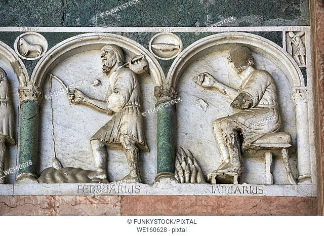 Late medieval relief sculpture depicting the labours for January and Feburary and astrological signs on the Facade of the Cattedrale di San Martino