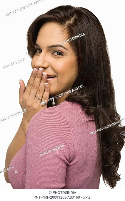 Woman covering her mouth with her hand and smiling