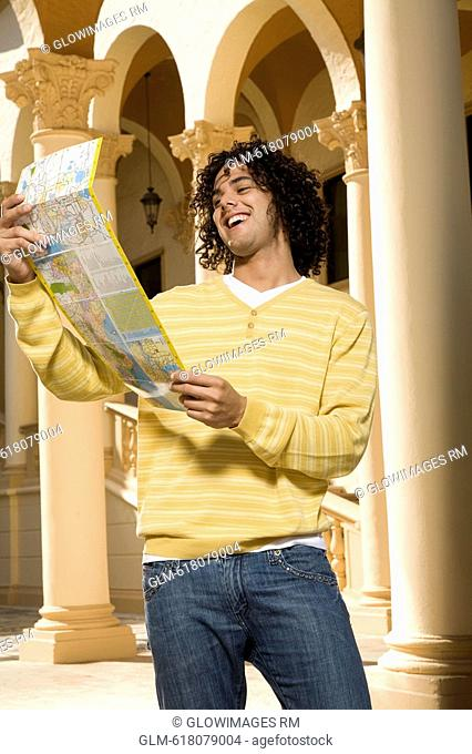 Man reading a map and smiling, Biltmore Hotel, Coral Gables, Florida, USA