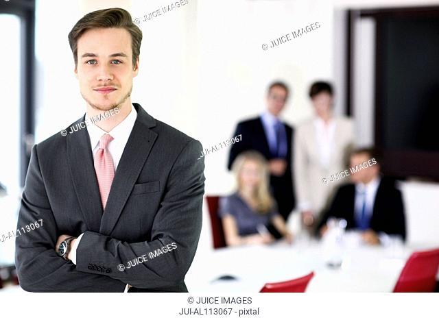 Businessman in meeting room, portrait