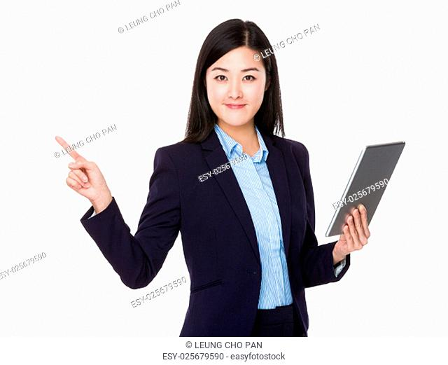Asian businesswoman use of tablet and finger pointing up