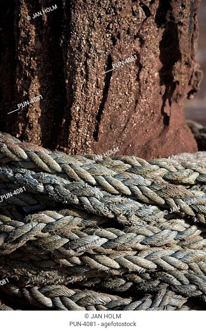 Rope wound round old capstan in Pennan harbour