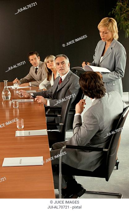 Woman addressing the boardroom