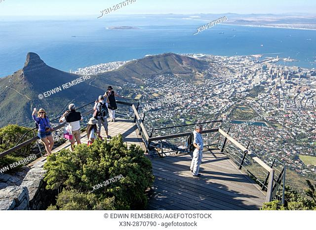 Tourists photographing the City Bowl of Cape Town, South Africa. Seen from the top of Table Mountain
