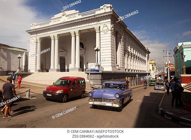 Old American car in front of the Museo Municipal Emilio Bacardi-Emilio Bacardi Museum in the city center, Santiago de Cuba, Cuba, Central America
