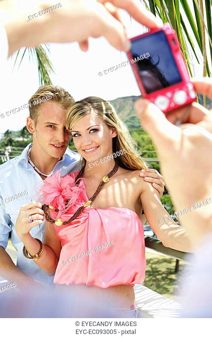 Young couple posing for photograph