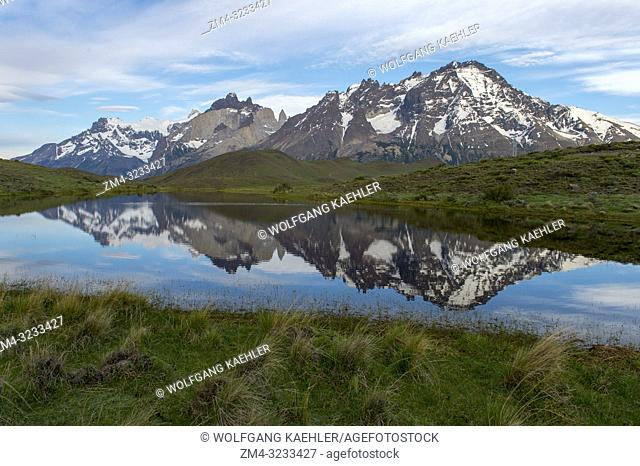 Cuernos del Paine and Almirante Nieto Mountains reflecting in small lake in Torres del Paine National Park in Patagonia, Chile