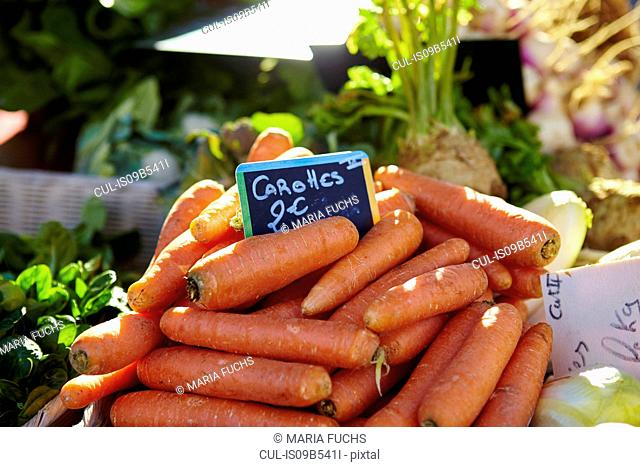 Stacked carrots on market stall, St Tropez, Cote d'Azur, France