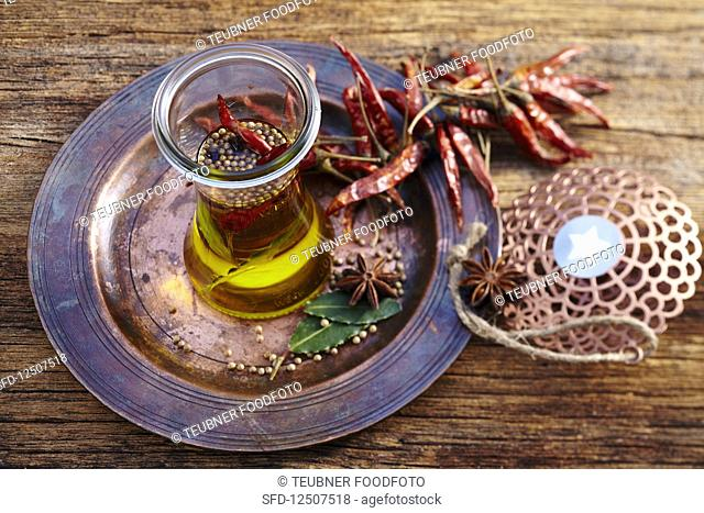 Homemade oriental spice oil in a glass