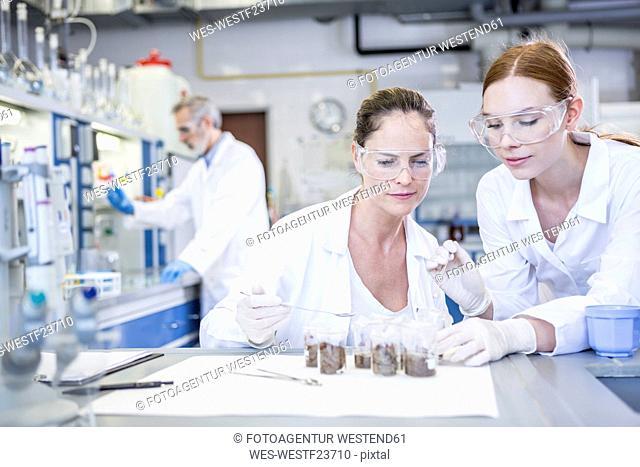 Scientists in lab examining sample