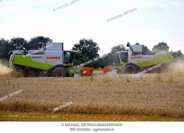 Two combine harvesters meet during the grain harvest in Dechow, Schalsee region, Mecklenburg-Western Pomerania, Germany, Europe