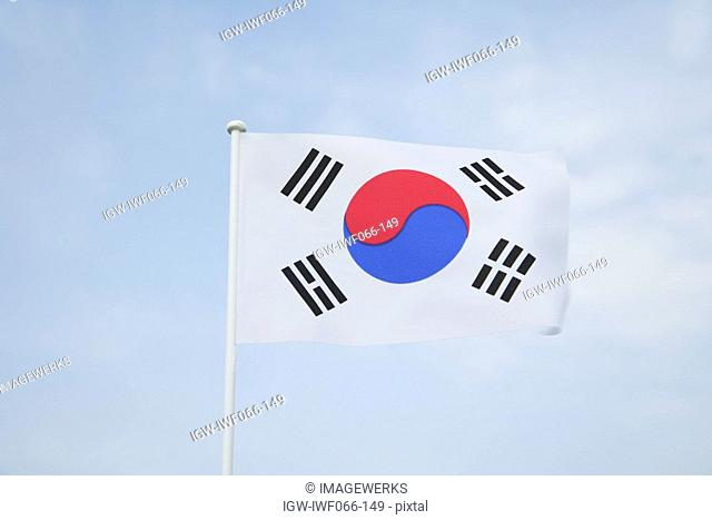 South Korean flag waving against sky, low angle view