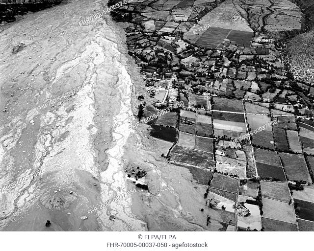 Aerial view of ice and mud avalanche destruction to mountain valley farmland, environmental disaster caused by rapid rise in temperature killed an estimated 4