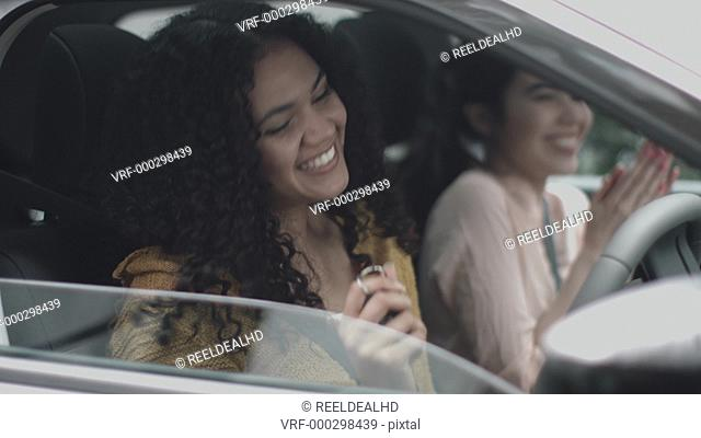 Excited young woman in new car