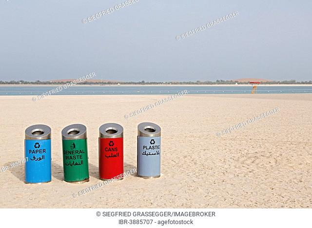Rubbish bins for sorting waste on the beach at Corniche Road, Abu Dhabi, United Arab Emirates