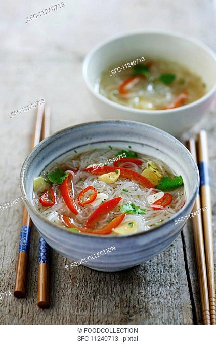 Cellophane noodle soup with ginger, chilli, garlic, peppers and coriander