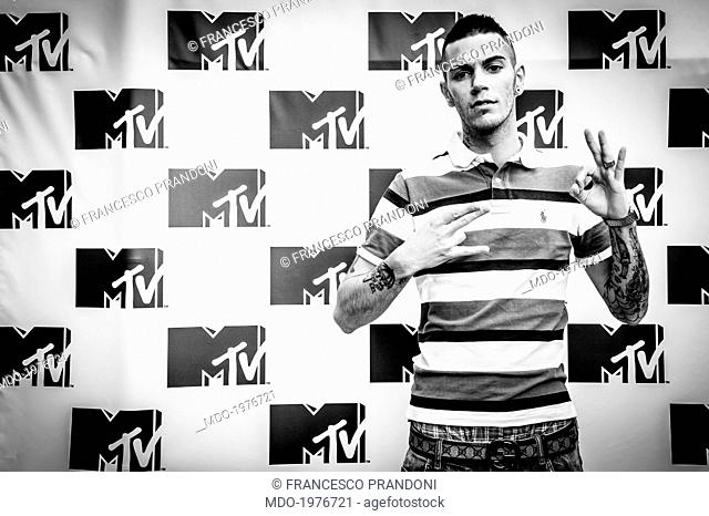 Italian rapper Emis Killa (Emiliano Rudolf Giambelli) posing for the TV broadcaster MTV. The rapper got a TRL Award as best up-and-coming artist 2012
