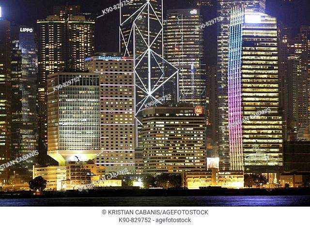 View across Hong Kong harbor to the colorful lights of the skyscrapers of Hong Kong Island in the night, Hong Kong, China, Southeast Asia