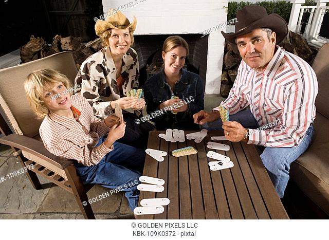 Portrait of a country family playing card game