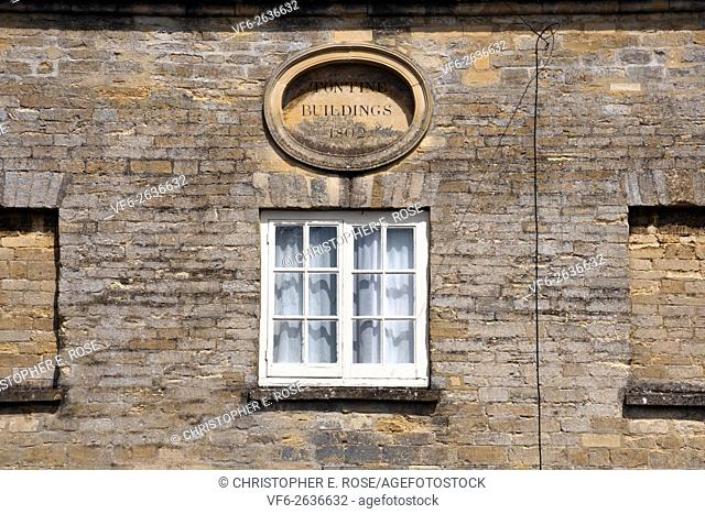 Detail of the historic Tontine Buildings, Cirencester, Gloucestershire, Cotswolds, UK