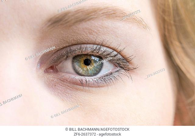 close-up of young womans eye and face blinking abstract MR model released