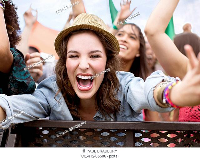 Close up of cheering woman at music festival