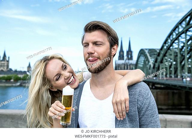 Germany, Cologne, young man tasting Koelsch