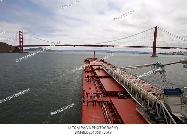 Golden Gate Bridge and freight ship