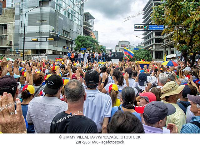 People march in protest against the government of Nicolás Maduro in the streets of Caracas on May,1 2017
