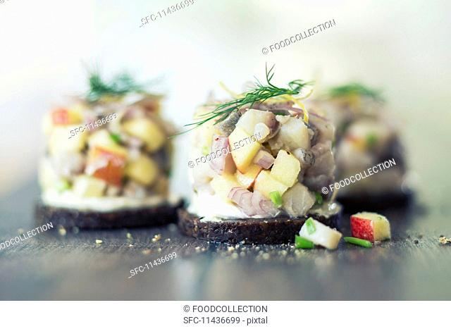 Pumpernickel topped with a soused herring