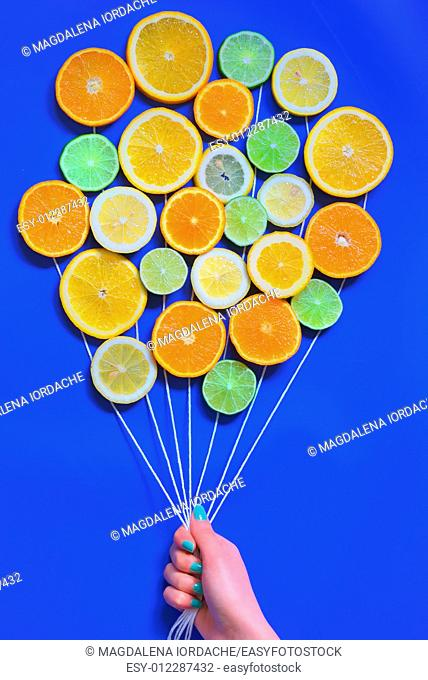 Abstract Citrus fruits bouquet on blue background