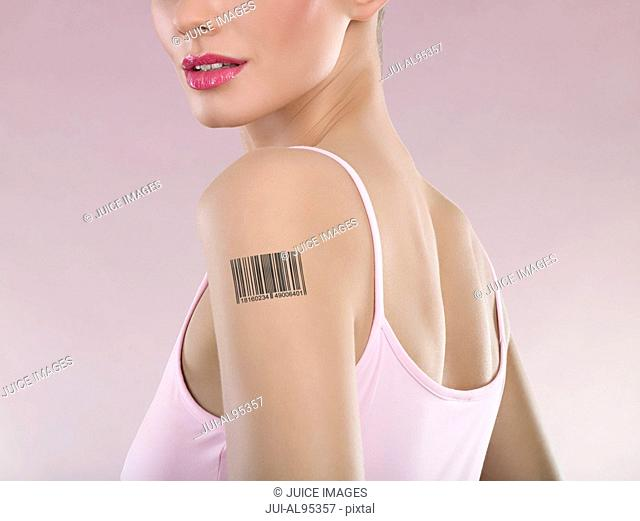 Woman with barcode on arm