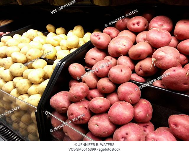 Yukon Gold and red potatoes at the supermarket in Washington State, USA