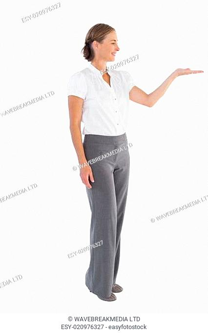Businesswoman presenting something with her hand on white background