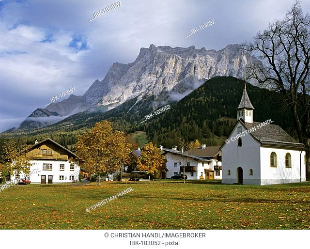 Old farmhouses in front of mountain Zugspitze, Ehrwald , Tyrol, Austria