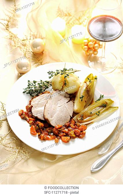 Roast pork with chicory and potato dumplings for Christmas