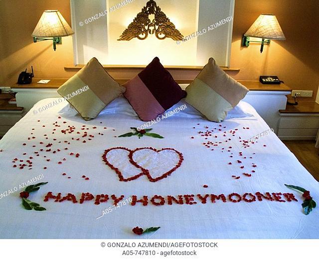 Happy honeymoon sign on bed at the Santiburi Dusit Resort, Ko Samui island, Surat Thani Province, Thailand