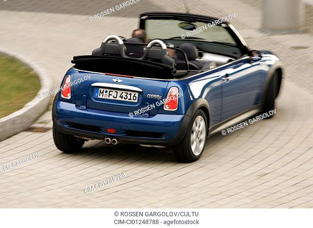 Mini Cooper S, model year 2004-, blue, open top, driving, diagonal from the back, rear view, City