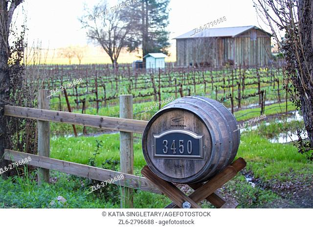 Barrel wooded sign with house number that leads to vineyards in Alexander Valley, Napa and Sonoma, a wine producing area of the California region