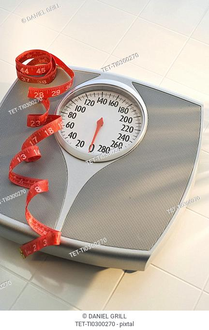 Bathroom scale and tape measure