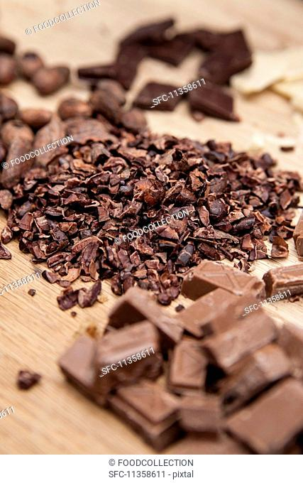 Pieces of chocolate and chopped cocoa beans