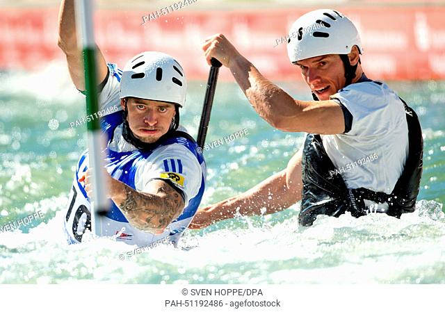 Tomas Kucera and Jan Batik of Slowakia paddle down the ice canal during the canoe double (C2) at the men's Canoe slalom World Cup final in Augsburg, Germany