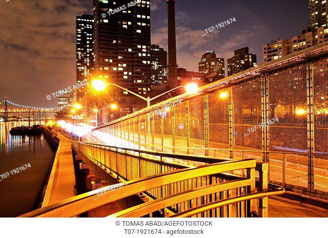 East River Drive aka FDR drive walkway path overlooking East River, Roosevelt Island, and Queensboro Bridge, Manhattan, New York City, USA