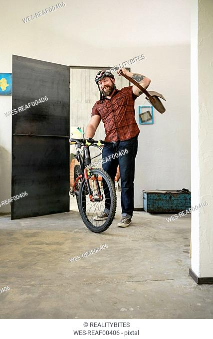 Portrait of man arriving in office with bicycle