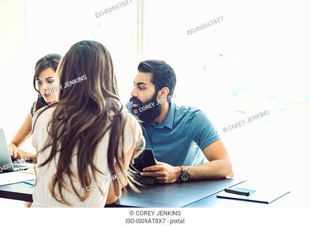 Business people in brainstorming meeting