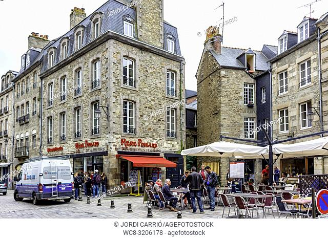 DINAN, BRITAN, FRANCE - JUNE -2015: Place de Cordeliers, in the medieval city of Dinan, where tourists were sitting on the terraces of the bars on June 22, 2015