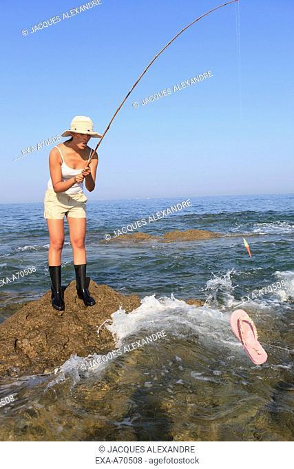 woman fishing a sandal