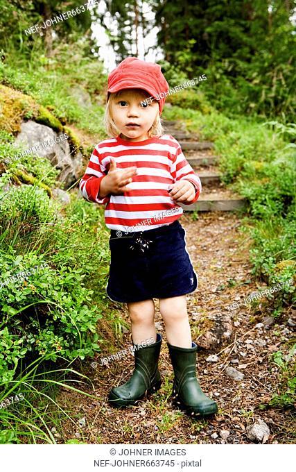 Boy eating bilberry, Sweden