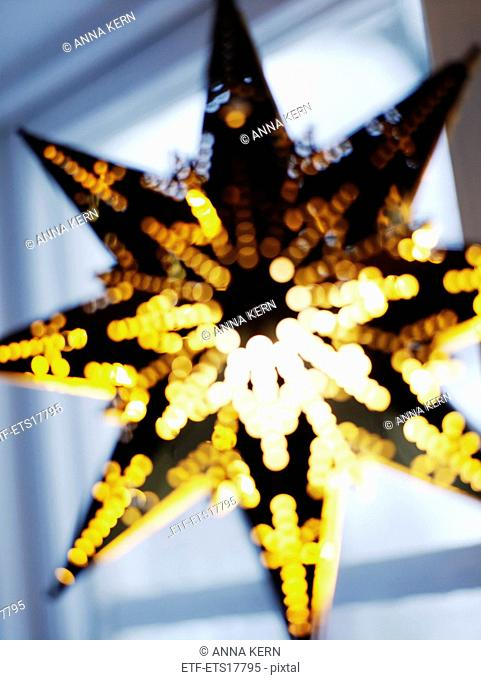 A star-shaped lantern hung in windows during Advent and Christmas