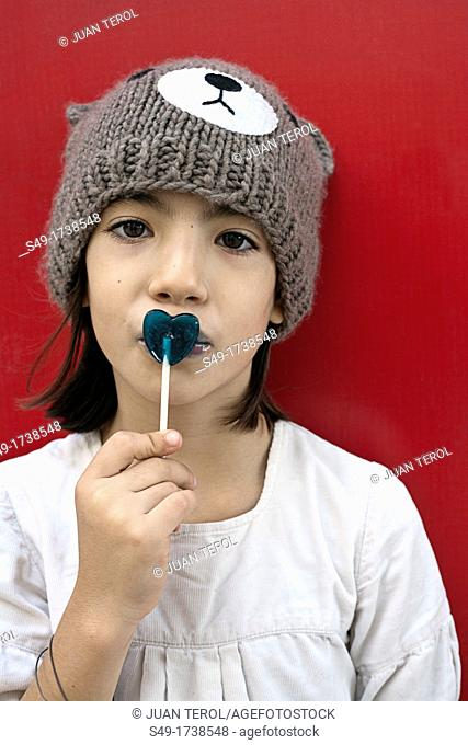 Young girl with lollipop candy